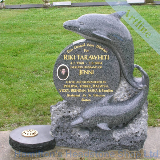 carved dolphins Headstone
