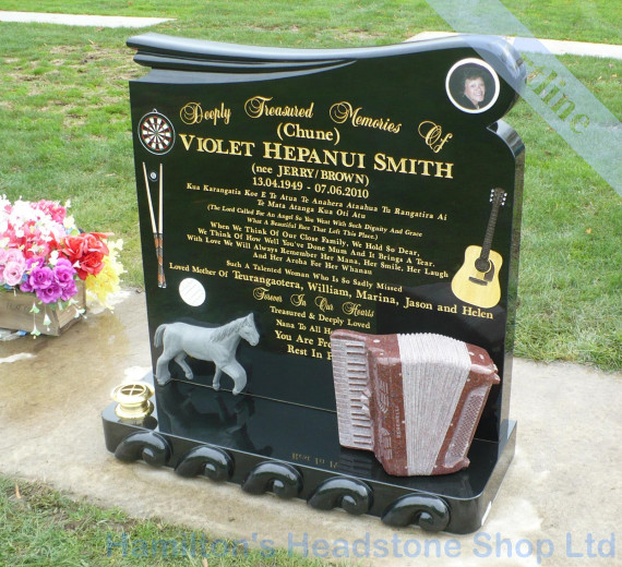 carved accordian  memorial headstone